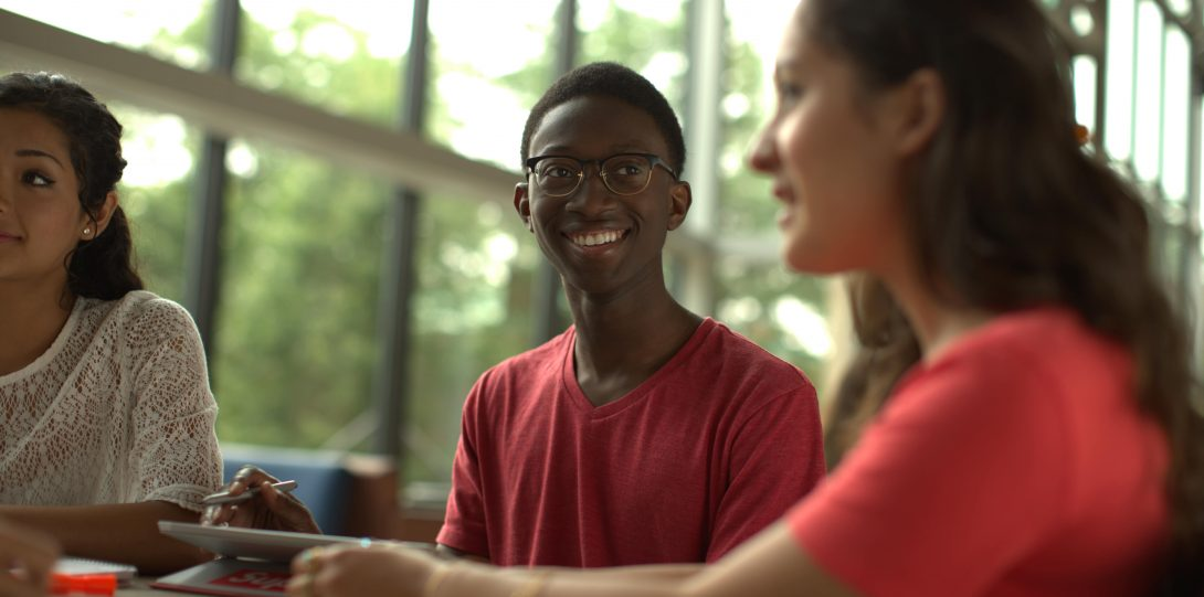 student smiling and sitting together